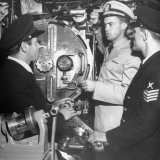 US Naval Officer Lieutenant Boyes Explains Torpedo Tube Door to Turkish Naval Petty Officers Premium Photographic Print by Ed Clark