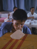Disabled South Vietnamese Soldier Casting a Vote into a Ballot Box at Cong Hoa Army Hospital Premium Photographic Print by Larry Burrows