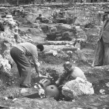 Archaeologist Excavationing Ancient Pots at Agora Ancient Market Place Premium Photographic Print by Dmitri Kessel