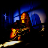 Jazz Singer Cassandra Wilson Playing Guitar, at Home Premium Photographic Print by Ted Thai