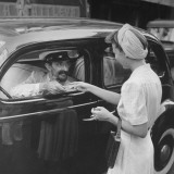A Woman Paying a Taxi Driver Premium Photographic Print by Hart Preston