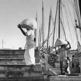 Men Unloading Goods from a Ship Premium Photographic Print by Hart Preston