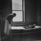 Old Woman Bent over the Foot of an Iron Bed in a Poorhouse Premium Photographic Print by Wallace Kirkland