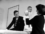 Senator Jack Kennedy Watching with Delight as His Wife Jackie Holds Up their Daughter Caroline Premium Photographic Print by Ed Clark