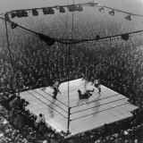 Boxing Ring as Heavyweight Champion Joe Louis Lies on Canvas, after Floored by Jersey Joe Walcott Premium-Fotodruck von Gjon Mili
