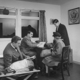 Business Men at US Consul in Airport Talking with Woman Premium Photographic Print by Nat Farbman