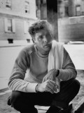 Actor Burt Lancaster, While Smoking Cigarette in Courtyard of Union Settlement House in E. Harlem Premium Photographic Print by Robert Wheeler