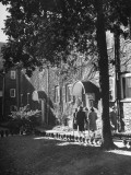 Female Students Walking by Dormitory, Sister&#39;s House, Built in 1796 by Moravians, at Salem College Premium Photographic Print by Gabriel Benzur