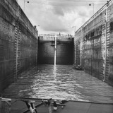 Boats Going Through the Canal Locks Premium Photographic Print by Thomas D. Mcavoy