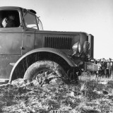 An Army Truck Being Towed Out of Thick Mud Premium Photographic Print by George Strock