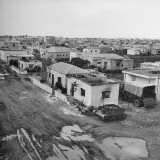 Burned Out Homes in Hatiqvah Area of Tel Aviv Premium Photographic Print by Dmitri Kessel