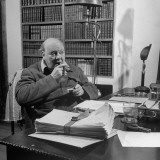 British Leader Winston Churchill Smoking a Cigar at His Desk Premium Photographic Print by Nat Farbman