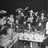 Soldiers Eating and Drinking During a Fiesta Premium Photographic Print by George Strock