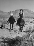 Kathryne Clifton and Her Brother Maurice Clifton Jr. Enjoy Horseback Riding in the Open Desert Premium Photographic Print by J. R. Eyerman