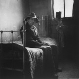Old Man Sitting Patiently on Old Iron Bed as He Waits for Mealtime at Poorhouse in Perry County Premium Photographic Print by Wallace Kirkland