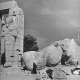 Fallen Figure of Ramses II Lying Among Ruins of Temple Premium Photographic Print by Eliot Elisofon