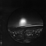 Large Convex Mirror's Dark Reflection of Distant A-Bomb Blast Premium Photographic Print by J. R. Eyerman