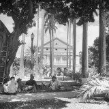 Men Relaxing on the Shadey Lawn in Front of the Department of the Interior Building Premium Photographic Print by Hart Preston