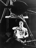 Heavyweight Boxing Contender Jerry Quarry Working Out on Punching Bag, Training at Caesar's Palace Premium Photographic Print by Richard Meek