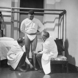 Doctors Examining Patient Hugh Johnson before His Artificial Hip Joint Operation Premium Photographic Print by Al Fenn