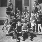 Children and Teacher Sitting Outside One-Room Country School Premium Photographic Print by Hansel Mieth