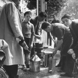 Men Gathering Left over Gas in Containers Premium Photographic Print by George Strock
