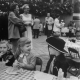 Candice Bergen Talking with Boy in Cowboy Outfit, During Outdoor Children's Party Premium Photographic Print by J. R. Eyerman