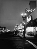 Many Stores and Street Lights Keeping the Town Bright All Night Premium Photographic Print by J. R. Eyerman