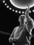 Conductor Herbert Von Karajan Raising Hand During Rehearsals in Unidentified Music Hall Premium Photographic Print