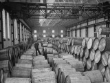 Half Ton Hogsheads of Tobacco, Stored in the Warehouse on King Albert Docks, Port of London Premium Photographic Print by Carl Mydans