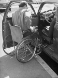 University of California at Los Angeles Paraplegic Getting into Drivers' Side of Car Premium Photographic Print by John Florea