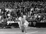 Helen Jacobs Reaching for the Tennis Ball During a Match at the Women's Singles Final Premium Photographic Print by John Phillips