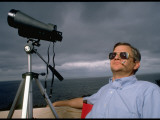 Novelist Tom Clancy with Tripod Mounted Binoculars Outside with Chesapeake Bay in Background Premium Photographic Print by Ted Thai