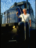 Conrail Freight Engineer Jim Metzger Standing on Train Cab in Rail Yard Premium Photographic Print by Ted Thai