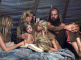 Tent-Dwelling Hippie Family of the Mystic Arts Commune Bray Family Reading Bedtime Stories Premium Photographic Print by John Olson