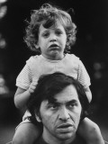 Bill Graham Carrying His Young Son David on His Shoulders Outside Home Premium Photographic Print by John Olson