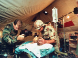 US Combat Casualty, Hooked to IV, in Tent Hospital, Operation Desert Storm Gulf War Premium Photographic Print by Dennis Brack