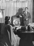 Producer David O. Selznick Standing at His Desk, Talking with Actress Anita Colby Premium Photographic Print by John Florea