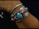 Closeup of Wrist with Turquoise and Red Coral and Silver Bracelet Made by Native Americans Premium Photographic Print by Michael Mauney