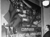 A Man Starring at a Communist Poster in the Communist Headquarters Premium Photographic Print by Paul Dorsey