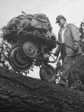 Hunter Pushing a Mechanical Jackass, Carrying Machine for Hunters Belongings Premium Photographic Print by J. R. Eyerman