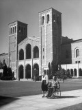 Paraplegic Richard Coleman and Wife Walking Past Royce Hall on Campus at UCLA Premium Photographic Print by John Florea
