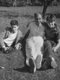 American Journalist Franklin Pierce Adams Sitting in the Grass with Two of His Sons Premium Photographic Print by Gabriel Benzur