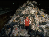Unidentified Man Standing in Giant Pile of Garbage RegardingExcessive Waste in US Premium Photographic Print by Ted Thai