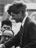 Senator Robert Kennedy as He Shakes Hands During Primary Election Campaign Premium Photographic Print by Bill Eppridge