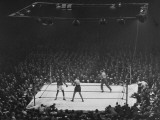 Joe Louis and Joe Walcott Boxing in Front of a Wide Eyed Crowd Premium Photographic Print by Andreas Feininger