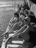 Santa Monica Life Guard's Party Aboard Boat, Girls Putting on Fins to Go Diving Premium Photographic Print by Peter Stackpole