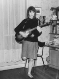French Singer Francoise Hardy Playing Guitar as She Practices at Home Premium Photographic Print by Stephane Richter