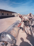 US Soldiers Examining Metal Cyclinder at Operation Desert Storm Premium Photographic Print by Dennis Brack