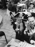 Art Linkletter in Pirate Hat Holds Microphone, Kneeling Next to David Ladd at Kid's Party Premium Photographic Print by J. R. Eyerman